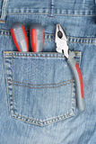 Screwdriver, nippers and pliers in the pocket Stock Photos