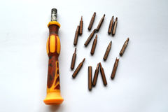 Screwdriver and nozzles. For her work Royalty Free Stock Images