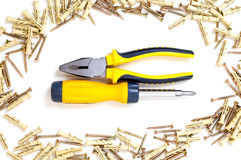 Screwdriver and pliers. Cruciform screwdriver and pliers in screw frame Stock Photo