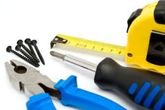Screwdriver and pliers Royalty Free Stock Images