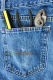 Screwdriver and Pliers in Blue Jean Pocket Royalty Free Stock Photos