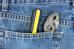 Screwdriver and Pliers in Blue Jean Pocket Royalty Free Stock Photo