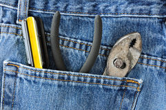 Screwdriver and Pliers in Blue Jeans Pocket Stock Photo