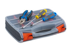 Screwdriver and pliers in tool box on white background. Screwdriver and pliers in plastic tool box on white background stock image