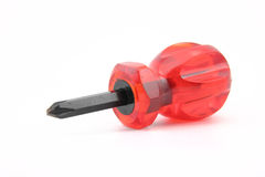 Screwdriver with red grasp Royalty Free Stock Photos