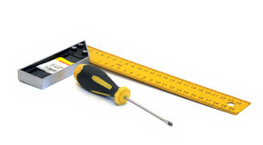 Screwdriver and ruler. Close-up (isolated Stock Image