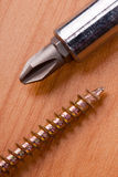 Screwdriver and screw Stock Image