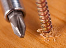 Screwdriver and screw Stock Photos