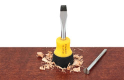 Screwdriver with screw on wood Stock Photography