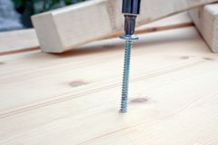 Screwdriver, screw and wood planks Stock Photography