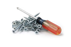 Screwdriver and screws Royalty Free Stock Images