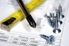 Screwdriver and screws Stock Images
