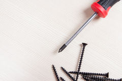 Screwdriver and screws Royalty Free Stock Photography