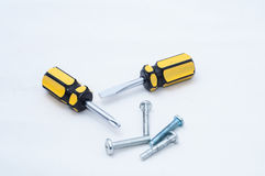Screwdriver and screws. Two screwdriver and some screws on white blackground Stock Photography