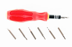 A screwdriver with a set of changable nozzels isolate on white b Royalty Free Stock Photography