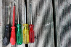 Screwdriver. Set of colored screwdrivers on textural background Stock Photo