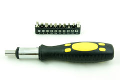 Screwdriver and set of heads Royalty Free Stock Photo