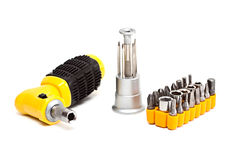 Screwdriver with set of nozzles. Royalty Free Stock Photos