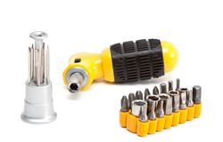 Screwdriver with set of nozzles. Stock Photo