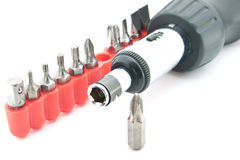Screwdriver with set of nozzles royalty free stock photo