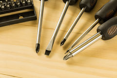 Screwdriver set. On wood table Stock Photography