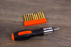 Screwdriver set. On a wooden background Royalty Free Stock Photos