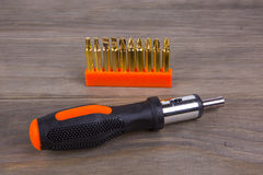 Screwdriver set. On a wooden background Stock Images