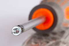 Screwdriver and small screw Stock Photos