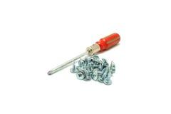 Screwdriver and small screws Stock Photos