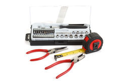 Screwdriver toolbox with set of bits, pliers and measuring tape Royalty Free Stock Image