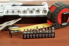 Screwdriver toolbox with set of bits, pliers and measuring tape Royalty Free Stock Images