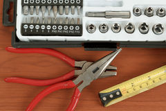 Screwdriver toolbox with set of bits, pliers and measuring tape Royalty Free Stock Photography