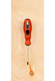 Screwdriver on a wooden board Royalty Free Stock Photos