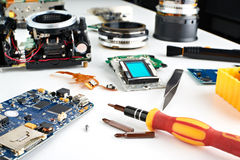 Screwdriver in workplace service engineer to repair cameras Royalty Free Stock Image