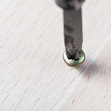 Screwdriver wraps screw Royalty Free Stock Image