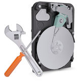 Screwdriver, wrench and disclosed hard drive Stock Photography