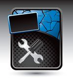 Screwdriver and wrench on blue cracked template Royalty Free Stock Images