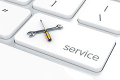 Screwdriver with wrench crossed icon on the computer keyboard. Royalty Free Stock Image