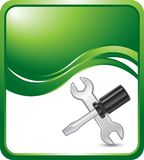 Screwdriver and wrench on green vertical wave Stock Image