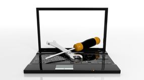 Screwdriver and wrench on laptop Royalty Free Stock Photos