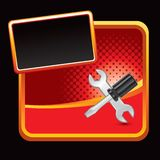 Screwdriver and wrench on red halftone banner Stock Images