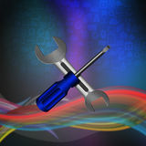 Screwdriver and wrench on social  background Stock Photography