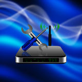 Screwdriver and wrench on wireless Router with the antenna illu Royalty Free Stock Image