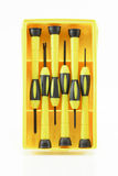 Screwdriver in the yellow package Royalty Free Stock Photos