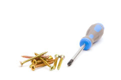 Screwdriver and yellow screws Stock Photos