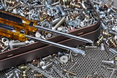Screwdrivers and components bolts, nuts, washers, screws Royalty Free Stock Image
