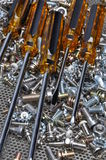 Screwdrivers and components bolts, nuts, washers, screws Stock Images