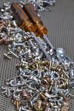 Screwdrivers and components bolts, nuts, washers, screws Stock Photos