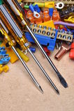 Screwdrivers and electrical components Stock Photo