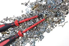 Screwdrivers and mixture chrome screws Royalty Free Stock Image
